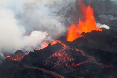A volcano erupting lava Description automatically generated with low confidence