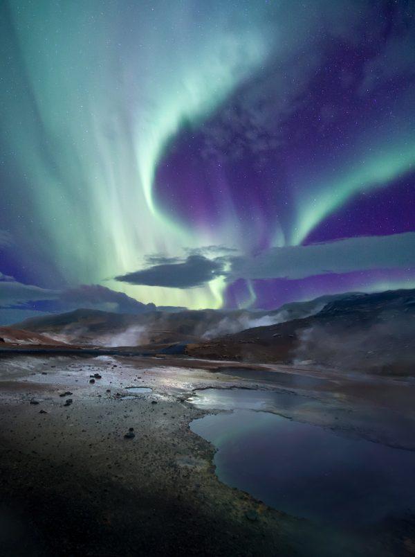 Aurora over Hot spring in Iceland